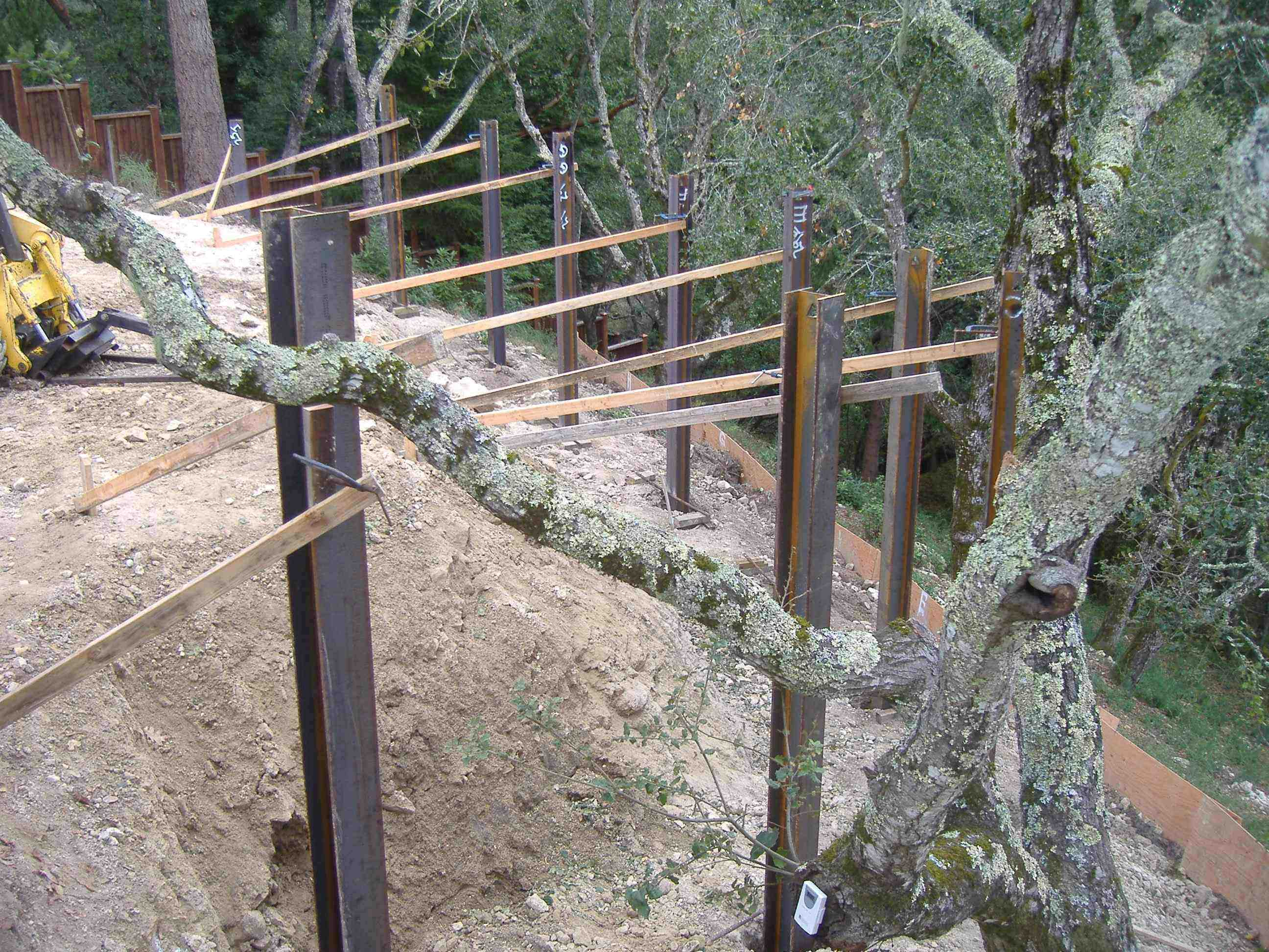 how to build a retaining wall using steel posts